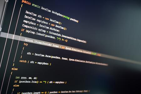 computer language: C# computer language source code on computer monitor. Stock Photo