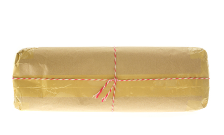 pack string: Parcel wrapped with brown kraft paper isolated on white background.