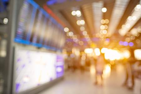 Blurred background of people traveling in Airport.