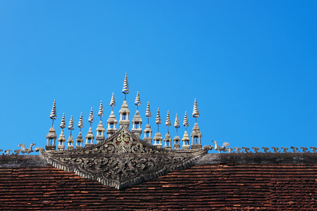 Gable apex in top layer of Luang Prabang temple roof in Laos. Stock fotó