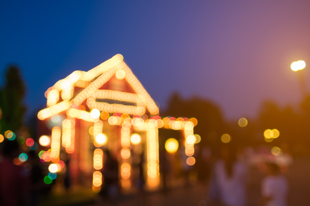 blurred image of christmas lights outside on a house stock photo 77880566