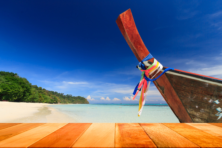Wood plank with long tail boat against blue sky and sea. Koh Rok island, Krabi, Thailand.