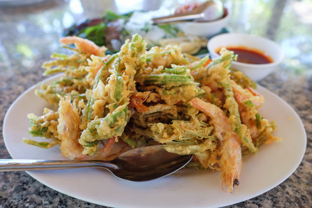 Crispy fried green vegetable with shrimp cracker. Bue tord Phuket food, Thailand.