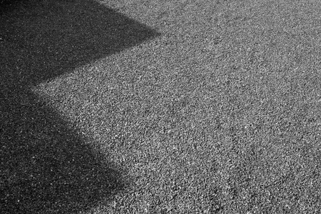 Shadow on Granite gravel of macadam, Rock blue gray crushed for construction on the ground, Scree texture background. Imagens