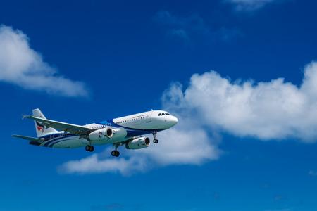 PHUKET, Thailand - April 8th, 2017 : Bangkok Airways airplane on the sky landing at Phuket International Airport, Mai Khao Beach, Phuket province, Southern of Thailand. Editorial