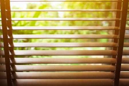 Wooden blinds with sun light. Reklamní fotografie