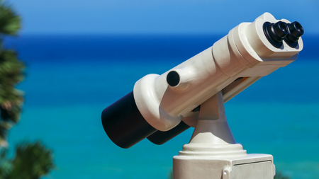 White coin operated binoculars camera setup at Phromthep cape viewpoint in Phuket, Thailand. Stok Fotoğraf