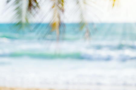Blurred image of sea and coconut tree. Concept of beach in summer.