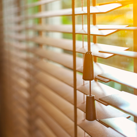 Wooden blinds with sun light. Banco de Imagens - 87066350