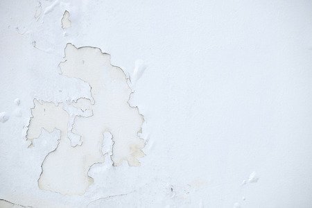Cracked paint on white wall.