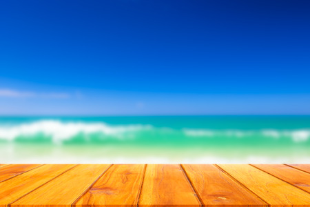 Wood plank with blurred sea background. Concept of beach in summer.