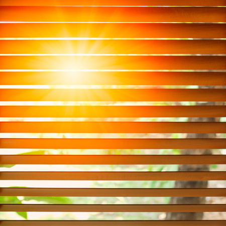 Wooden blinds with sun rays.