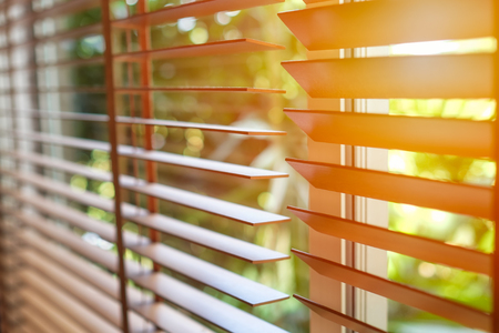 Wooden blinds with sun light. Stockfoto