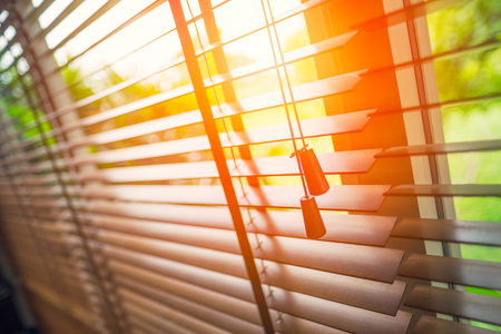 Wooden blinds with sun light. Banque d'images