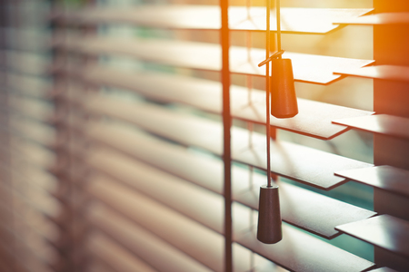 Wooden blinds with sun light. Vintage color style. Stock Photo