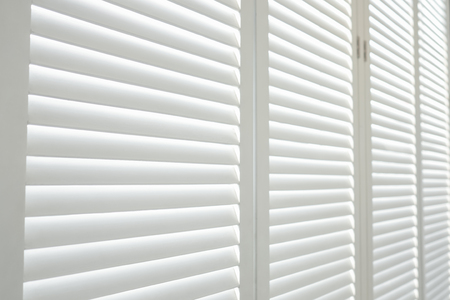 White wooden shutters, White wooden blind. Reklamní fotografie - 95642812