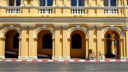 Vintage bicycle on the street with Sino-Portuguese architecture at Phuket old town, Thailand. Reklamní fotografie