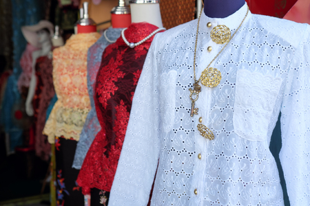 Nyonya dresses is sold along the street of Phuket old town, Thailand. Reklamní fotografie