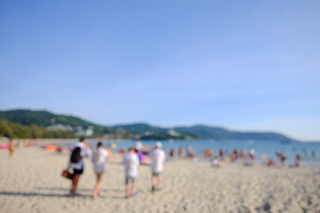 Blurred image. Group of friends walking on the beach. Reklamní fotografie