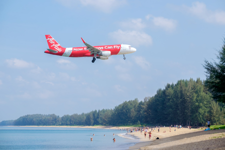 PHUKET, THAILAND - MARCH 01, 2018: Air Asia airline landing at Phuket International Airport, Mai Khao Beach, Phuket province, Southern of Thailand.