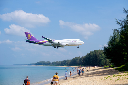 PHUKET, THAILAND - MARCH 01, 2018: Thai airways airplane landing at Phuket International Airport, Mai Khao Beach, Phuket province, Southern of Thailand.