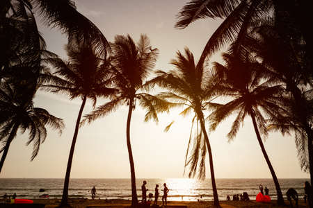 Silhouette of people on sunset, Surin Beach, Phuket Island, Thailand.