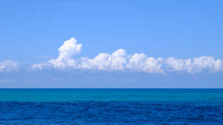 Blue sea with sky background.