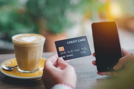 Online shopping by credit card through the mobile application. Online payment Concept.