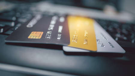 Close up image of credit cards on a keyboard of computer. Concept for e-commerce.