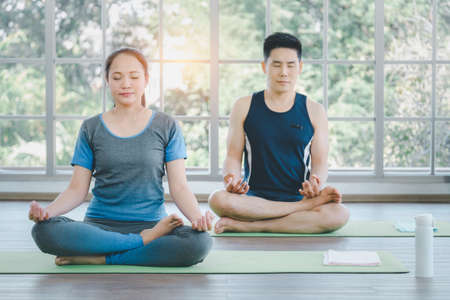 Asian family couple doing exercise and yoga at home. Stay home, quarantine workout.
