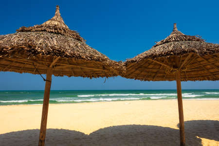 Beach umbrellas in front of the My Khe beach in Da Nang, Vietnam.