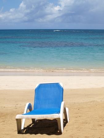 lounge chair on a beach photo