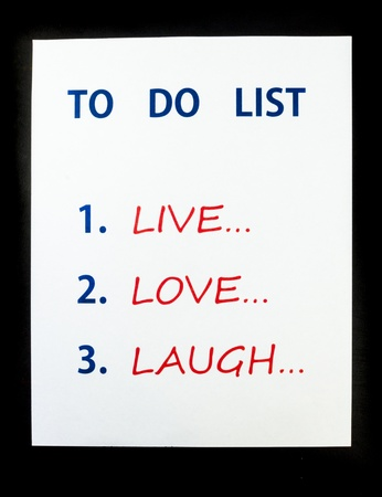 To Do List to Live, Love, Laugh on black background Stock Photo