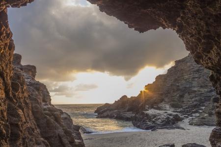 Sunrise view of Halona CoveEternity Beach from inside a lava tube