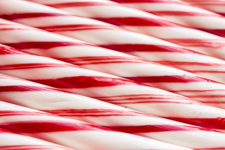 Macro pattern of multiple red and white peppermint candy canes photo