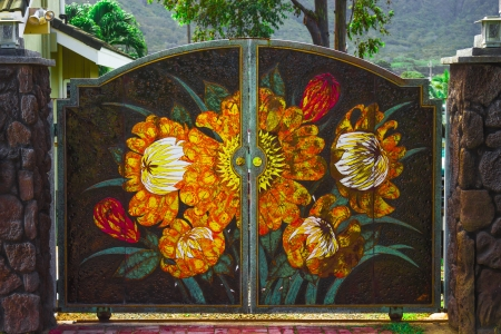 ornately: Colorful ornately decorated gate painted with flowers