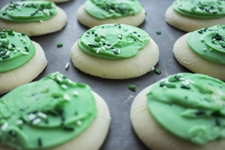 Green frosted sugar cookies with shamrock sprinkles photo