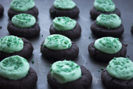 Green mint frosted mini chocolate cookies with green sugar sprinkles