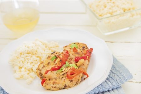 Baked honey mustard chicken thighs with roasted red bell peppers, toasted almonds and parsley photo