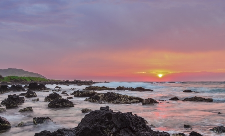 intensely: Intensely colorful sunrise over the ocean at Sandy Beach in Oahu, Hawaii Stock Photo