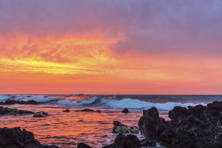 Intensely colorful sunrise over the ocean at Sandy Beach in Oahu, Hawaii Stock Photo