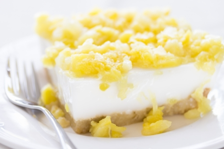 Creamy coconut pudding pie on macadamia nut crust and topped with chopped pineapples