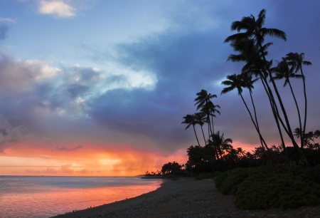 Beautiful colorful sunset with distant rain from Kawaikui Beach Park on Oahu, Hawaii