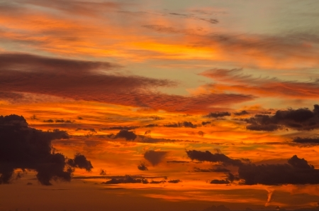 Beautiful cloudy sky with intense colors at sunrise Stock Photo
