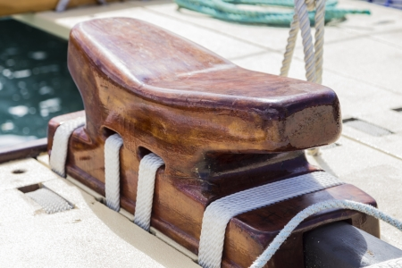 cleat: A large wooden cleat onboard the deck of a sailing vessel