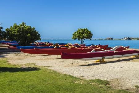 outrigger: Colorful group of outrigger canoes at the shore Stock Photo
