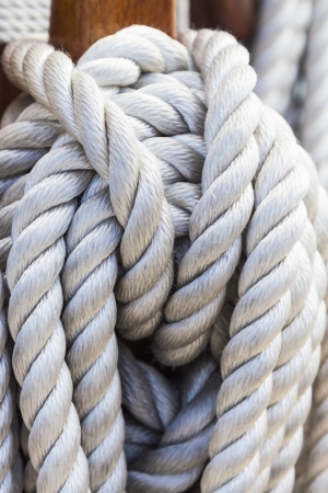 Details of sail rope on the mast of a sailboat photo