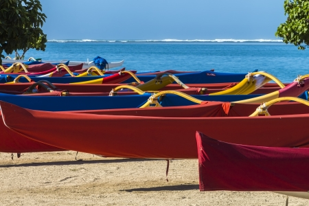Colorful group of outrigger canoes at the shore Stock Photo