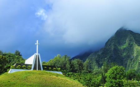A burial temple on a hill in Valley Of The Temples with the Koolau Mountains in the background on Oahu, Hawaii photo