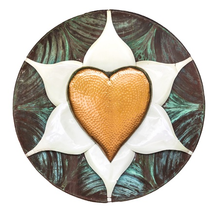 patina: A dimpled copper heart on a white metal flower inside of a brushed disk with patina
